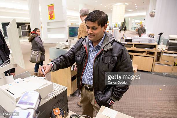 TORONTO ON FEBRUARY 23 Abu Siddiki has worked in the electronic department in Sears for 8 years This is a photograph of him swiping out for the last...