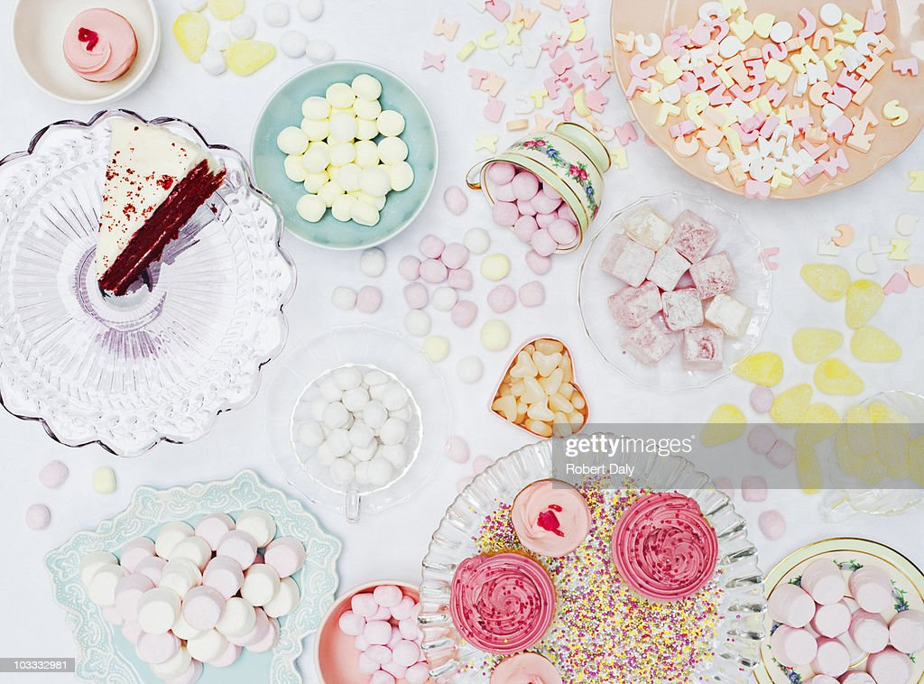 Abundant variety of vibrant sweets in dishes on table : Stock Photo