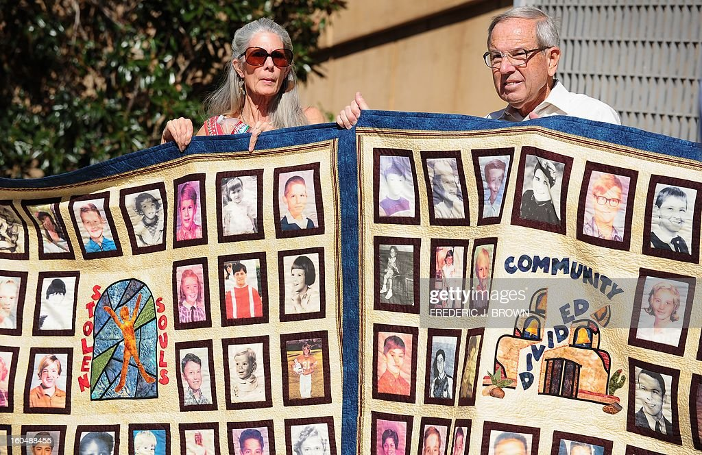 Abuse victims and their supporters hold quilts bearing portraits of abused children while gathered outside the Cathedral of Our Lady of the Angels in Los Angeles, California, on February 1, 2013,, one day after the release of personnel files of priests accused of sexual misconduct. The archbishop of Los Angeles Jose Gomez stripped his predecessor, retired Cardinal Roger Mahony, of all church duties on January 31. In all, 124 files were released on the Los Angeles archdiocese's website, listed by priests' names, including 82 containing information on allegations of childhood sexual abuse. AFP PHOTO / Frederic J. BROWN