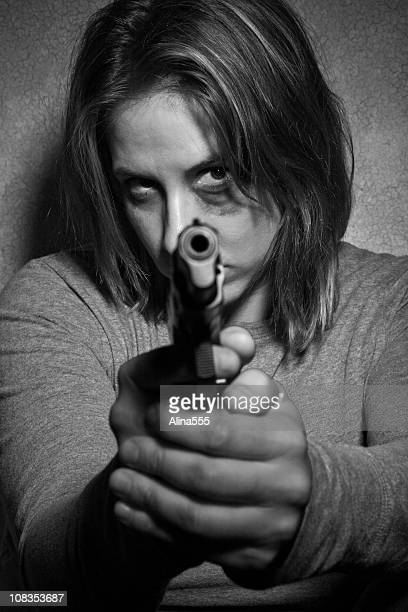 Abused woman protecting herself with a gun