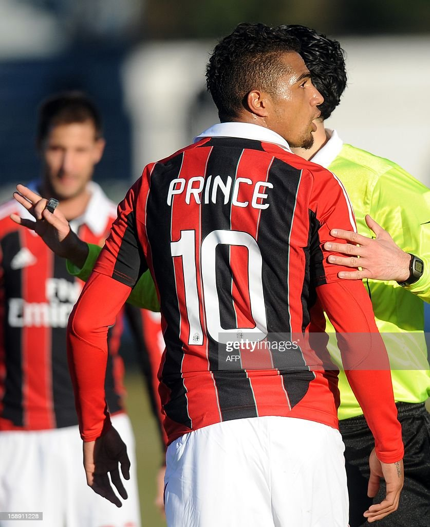 Ac Milan's Ghanaian defender Prince Kevin Boateng leaves the pitch during the friendly football match between Pro Patria and Ac Milan in Busto Arsizio on January 3, 2013. Boateng stormed off the pitch after racist chants from a group of fans on Thursday, forcing a friendly away game against fourth-tier club Pro Patria to be suspended. 'Shame that these things still happen,' the 25-year-old German-born Ghanaian player said on his Twitter account after the match was stopped in the 26th minute when he led his team off the pitch. Boateng picked up the ball, kicked it towards the stands and walked off the pitch in Pro Patria's home town of Busto Arsizio near Milan.