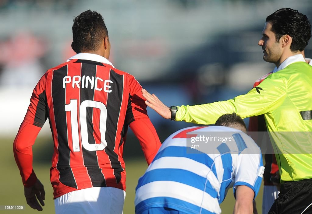 Ac Milan's Ghanaian defender Prince Kevin Boateng leaves the pitch during the friendly football match between Pro Patria and Ac Milan in Busto Arsizio on January 3, 2013. Boateng stormed off the pitch after racist chants from a group of fans on Thursday, forcing a friendly away game against fourth-tier club Pro Patria to be suspended. 'Shame that these things still happen,' the 25-year-old German-born Ghanaian player said on his Twitter account after the match was stopped in the 26th minute when he led his team off the pitch. Boateng picked up the ball, kicked it towards the stands and walked off the pitch in Pro Patria's home town of Busto Arsizio near Milan. AFP PHOTO / ALBERTO LINGRIA