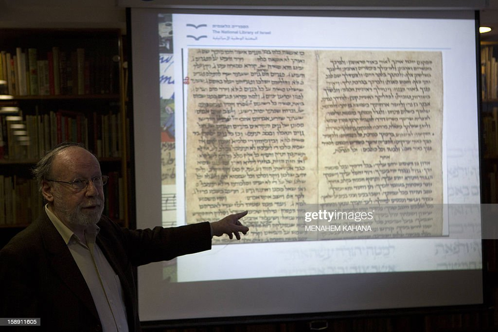 Academic director of the National Library of Israel professor Haggai Ben-Shammai points to a projection of a document from a collection of discarded religious Jewish writings, discovered inside caves in a Taliban stronghold in northern Afghanistan, which date back from the 10th century during a press conference on January 3, 2013, at the national library in Jerusalem. The national library recently acquired 29 items from the collection, or Genizah, which contains the first-ever documentation of the religious, cultural and commercial life of the Jewish community in that era and area.