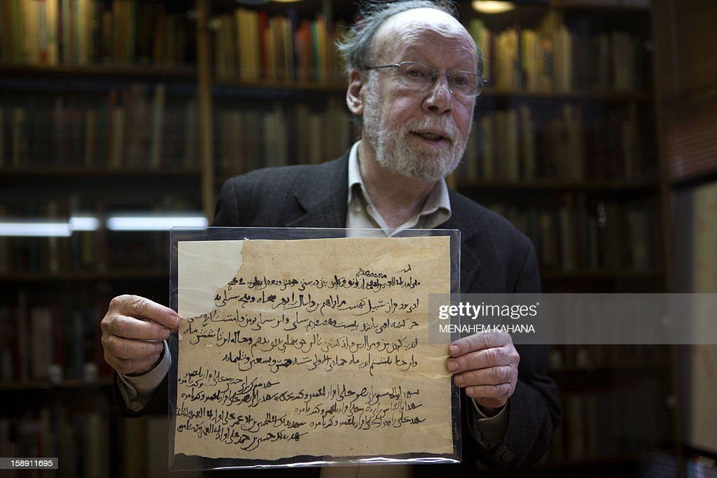 Academic director of the National Library of Israel professor Haggai Ben-Shammai displays a document from a collection of discarded religious Jewish writings discovered inside caves in a Taliban stronghold in northern Afghanistan which date back from the 10th century during a press conference on January 3, 2013, at the national library in Jerusalem. The national library recently acquired 29 items from the collection, or Genizah, which contains the first-ever documentation of the religious, cultural and commercial life of the Jewish community in that era and area.