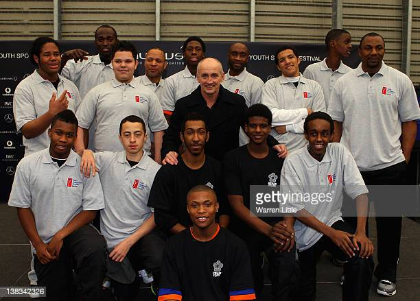 Academy Ambassador Barry McGuigan poses with youngsters as he attends the Laureus Sport for Good Youth Festival at Millwall Football Club's Lions...
