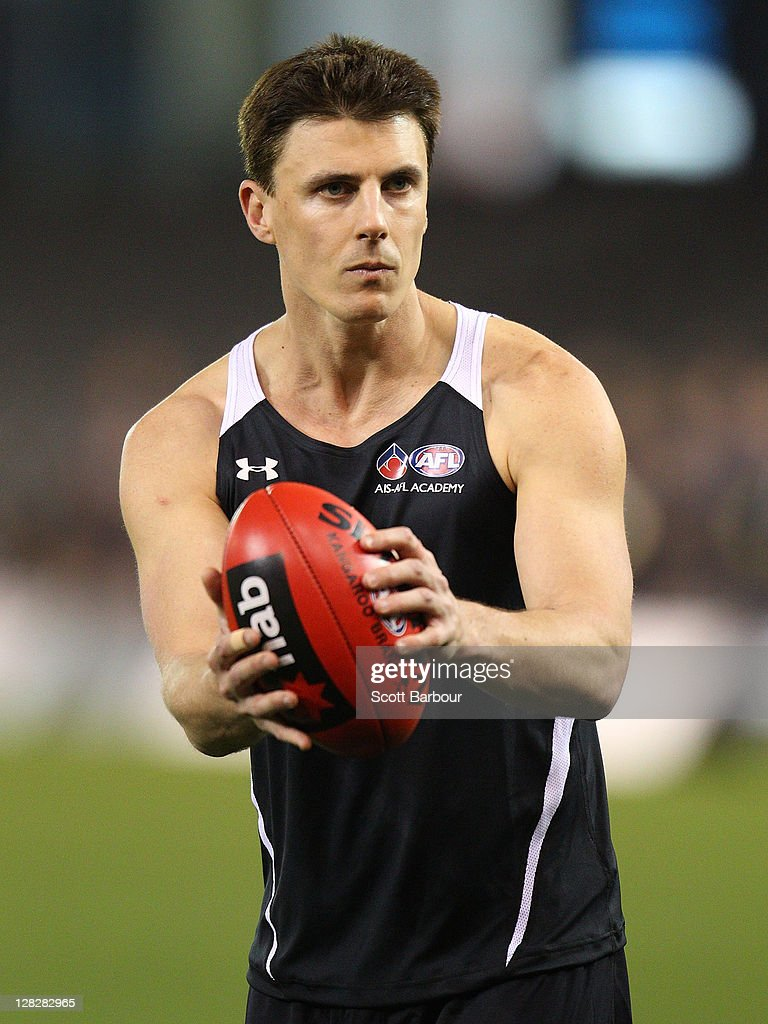 Academy Assistant Coach Matthew Lloyd looks to pass the ball during the 2011 AFL Draft Combine at Etihad Stadium on October 6 2011 in Melbourne...