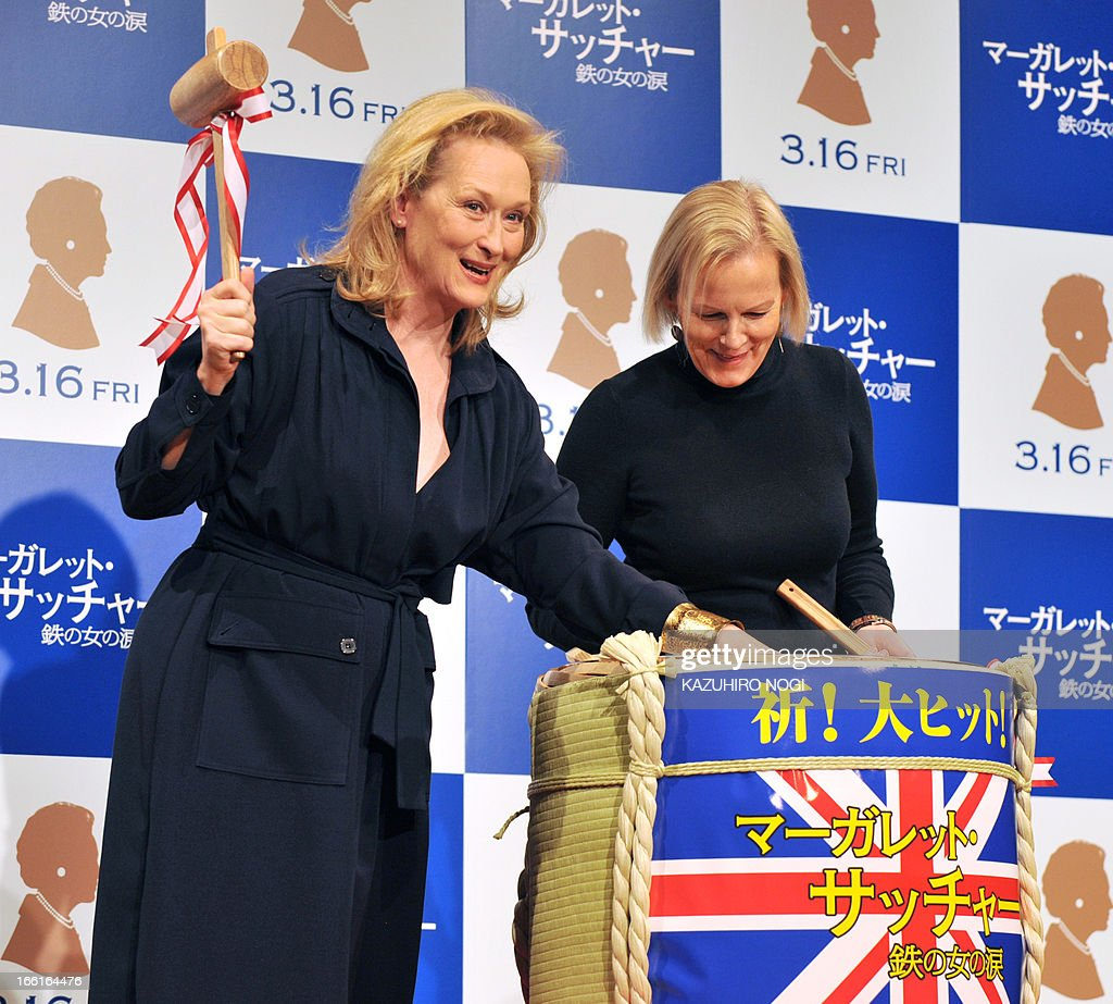 Academy award US winning actress Meryl Streep (L) and British director Phyllida Lloyd open a lid of a sake cask after the breaking ceremony to promote her latest movie 'The Iron Lady' in Tokyo March 7, 2012. The 62-year-old Streep picked up her third Oscar in February for her role as former British premier Margaret Thatcher in 'The Iron Lady', underscoring her status as the pre-eminent actress of her generation.