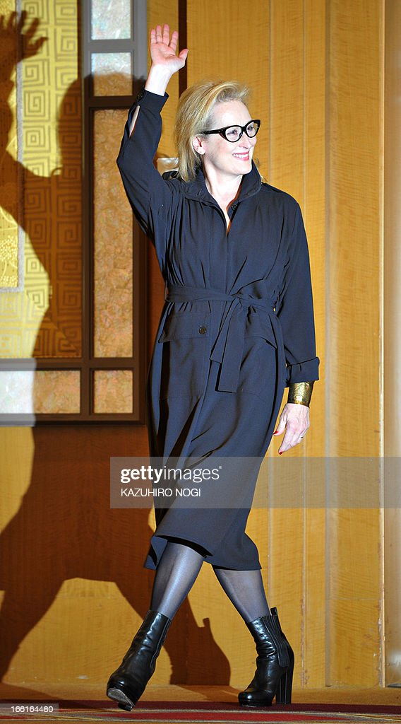 Academy award US winning actress Meryl Streep waves as she arrives prior to a press conference to promote her latest movie 'The Iron Lady' in Tokyo March 7, 2012. The 62-year-old Streep picked up her third Oscar in February for her role as former British premier Margaret Thatcher in 'The Iron Lady', underscoring her status as the pre-eminent actress of her generation.