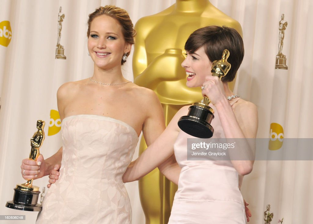 Academy Award Winners (L-R) Actress <a gi-track='captionPersonalityLinkClicked' href=/galleries/search?phrase=Jennifer+Lawrence&family=editorial&specificpeople=1596040 ng-click='$event.stopPropagation()'>Jennifer Lawrence</a>, Actress <a gi-track='captionPersonalityLinkClicked' href=/galleries/search?phrase=Anne+Hathaway+-+Actrice&family=editorial&specificpeople=11647173 ng-click='$event.stopPropagation()'>Anne Hathaway</a> in the press room during the 85th Annual Academy Awards held at the Loews Hollywood Hotel on February 24, 2013 in Hollywood, California.
