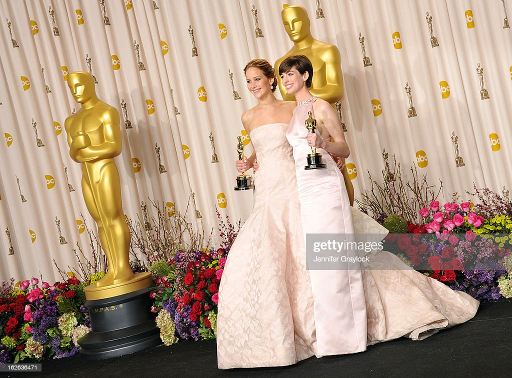 Academy Award winners (L-R) actresses Jennifer Lawrence and Anne Hathaway pose in the press room during the 85th Annual Academy Awards held at the Loews Hollywood Hotel on February 24, 2013 in Hollywood, California.
