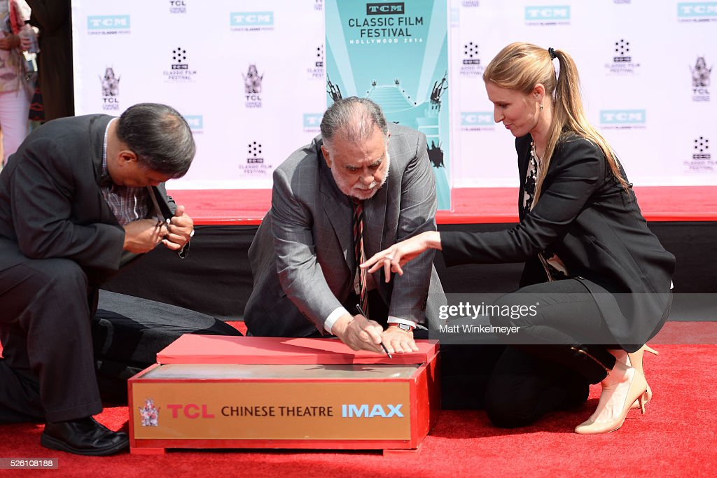 Academy Award winning filmmaker <a gi-track='captionPersonalityLinkClicked' href=/galleries/search?phrase=Francis+Ford+Coppola&family=editorial&specificpeople=204241 ng-click='$event.stopPropagation()'>Francis Ford Coppola</a> writes his name in cement as TCM honors him with a Hand/Footprint Ceremony at TCL Chinese Theatre IMAX on April 29, 2016 in Hollywood, California.