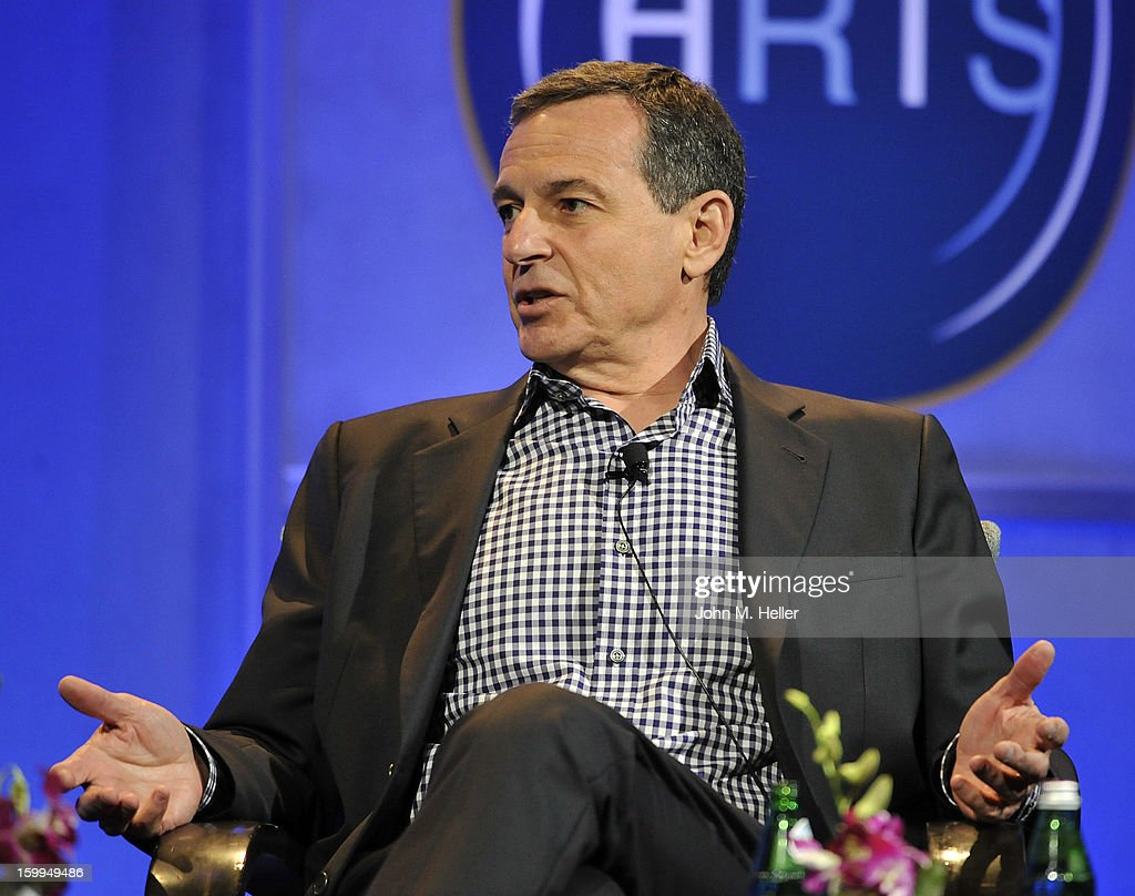 Academy Award Winning Producer and Co-Chairman of Imagine Entertainment Brian Grazer interviews Chairman & Chief Executive Officer of the Walt Disney Company Robert A. Iger at the Hollywood Radio & Television Society Newsmaker Luncheon Series at The Beverly Hilton Hotel on January 23, 2013 in Beverly Hills, California.