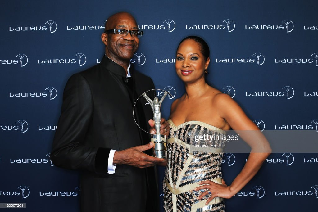 Academy Chairman Edwin Moses and wife Michelle pose with the trophy during the 2014 Laureus World Sports Awards at the Istana Budaya Theatre on March 26, 2014 in Kuala Lumpur, Malaysia.