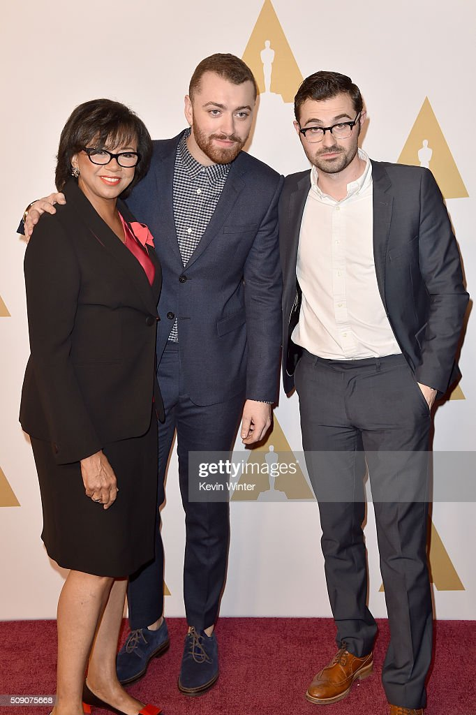 Academy of Motion Picture Arts and Sciences President <a gi-track='captionPersonalityLinkClicked' href=/galleries/search?phrase=Cheryl+Boone+Isaacs&family=editorial&specificpeople=725500 ng-click='$event.stopPropagation()'>Cheryl Boone Isaacs</a>, singer-songwriter <a gi-track='captionPersonalityLinkClicked' href=/galleries/search?phrase=Sam+Smith+-+Singer&family=editorial&specificpeople=12336931 ng-click='$event.stopPropagation()'>Sam Smith</a>, and songwriter <a gi-track='captionPersonalityLinkClicked' href=/galleries/search?phrase=Jimmy+Napes&family=editorial&specificpeople=13906256 ng-click='$event.stopPropagation()'>Jimmy Napes</a> attend the 88th Annual Academy Awards nominee luncheon on February 8, 2016 in Beverly Hills, California.