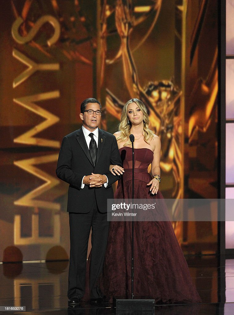 Academy of Television Arts & Sciences Chairman & CEO Bruce Rosenblum and actress <a gi-track='captionPersonalityLinkClicked' href=/galleries/search?phrase=Kaley+Cuoco&family=editorial&specificpeople=208988 ng-click='$event.stopPropagation()'>Kaley Cuoco</a> speak onstage during the 65th Annual Primetime Emmy Awards held at Nokia Theatre L.A. Live on September 22, 2013 in Los Angeles, California.