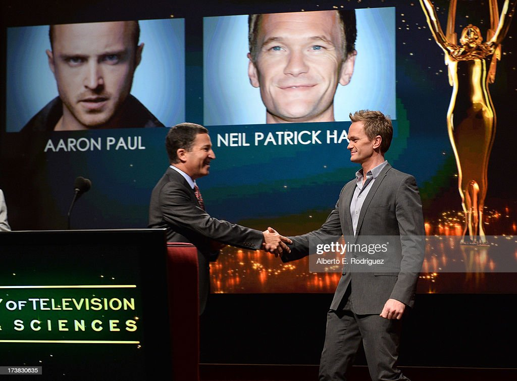 Academy of Television Arts & Sciences Chairman & CEO Bruce Rosenblum (L) greets actor Neil Patrick Harris onstage at the 65th Primetime Emmy Awards nominations at the Television Academy's Leonard H. Goldenson Theatre on July 18, 2013 in North Hollywood, California.