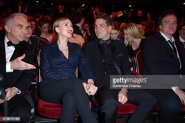 Academy president Alain Terzian actress Scarlett Johansson Romain Dauriac and director Quentin Tarantino sit in the audience before the start of the...