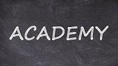 Academy written on blackboard