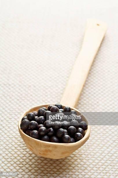Acai berries in spoon
