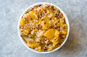 Acai Bowl / Quinoa with Tropical Fruits Mango, Papaya and Pineapple. Organic Food.