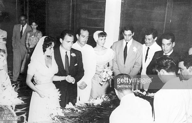 Movie actress Elizabeth Taylor and film producer Mike Todd were married here tonight in simple civil ceremony attended by small group of relatives...