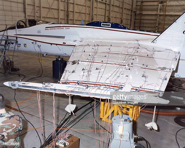 Accelerometers and sensors cover the Active Aeroelastic Wing of an F/A-18 test aircraft.