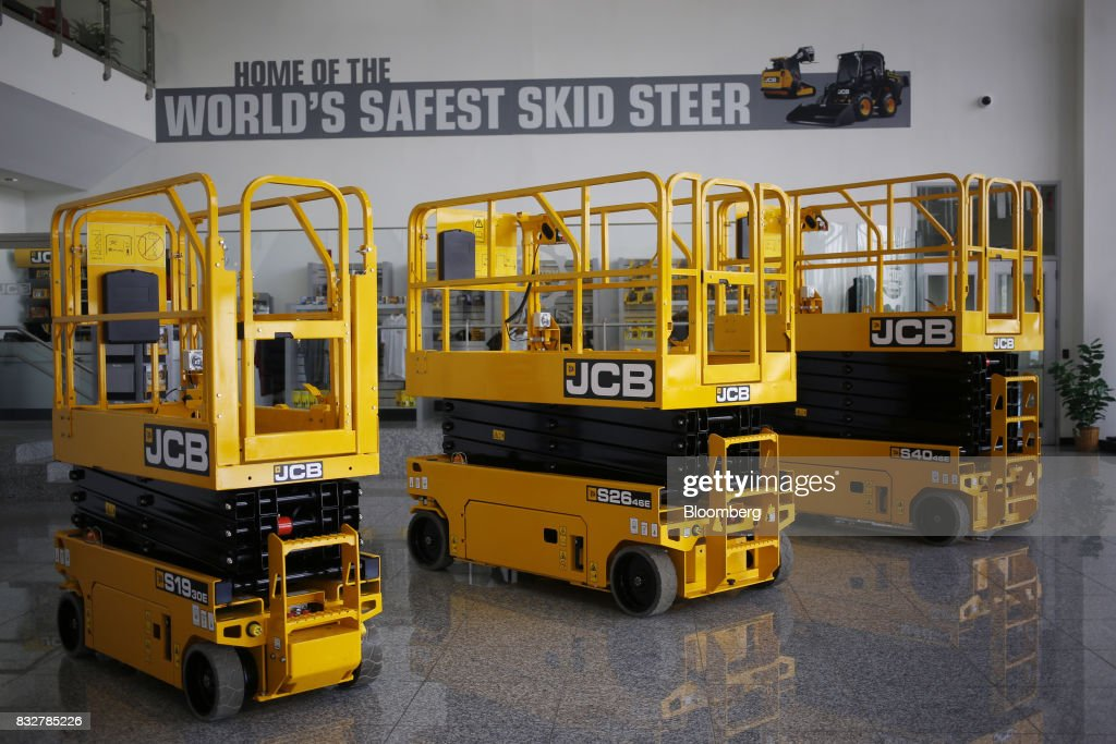Access platforms sit on display inside the lobby of the JC Bamford Excavators LTD. (JCB) manufacturing plant in Pooler, Georgia, U.S., on Friday, Aug. 11, 2017. The Federal Reserve is scheduled to release industrial production figures on August 17. Photographer: Luke Sharrett/Bloomberg via Getty Images