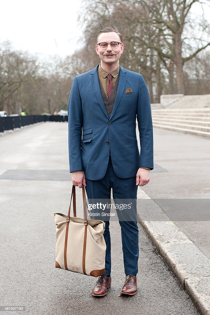 Accessories Designer at Burberry Ben Wykes wears a Burberry shirt and Bag, Grenson shoes, TK Max suit, Reiss waistcoat and vintage glasses day 3 of London Mens Fashion Week Autumn/Winter 2014, on January 08, 2014 in London, England.