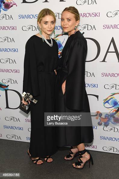 Accessories designer of the year award recipients MaryKate Olsen and Ashley Olsen of The Row attend the winners walk during the 2014 CFDA fashion...