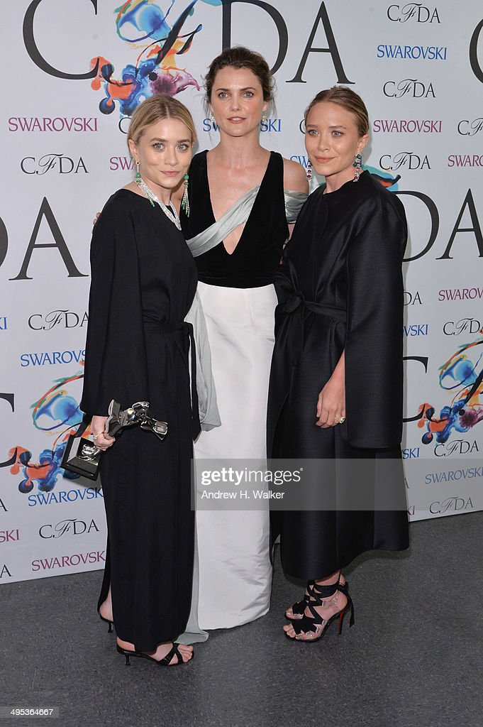 Accessories designer of the year award recipients <a gi-track='captionPersonalityLinkClicked' href=/galleries/search?phrase=Mary-Kate+Olsen&family=editorial&specificpeople=156430 ng-click='$event.stopPropagation()'>Mary-Kate Olsen</a> and <a gi-track='captionPersonalityLinkClicked' href=/galleries/search?phrase=Ashley+Olsen&family=editorial&specificpeople=156429 ng-click='$event.stopPropagation()'>Ashley Olsen</a> of The Row pose with <a gi-track='captionPersonalityLinkClicked' href=/galleries/search?phrase=Keri+Russell&family=editorial&specificpeople=203250 ng-click='$event.stopPropagation()'>Keri Russell</a> (C) at the winners walk during the 2014 CFDA fashion awards at Alice Tully Hall, Lincoln Center on June 2, 2014 in New York City.