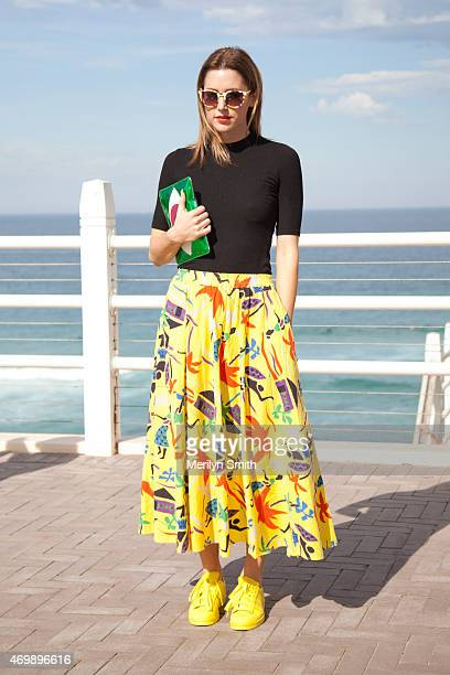 Accessories Designer Poppy Lissiman wears her own design bag and sunglasses Topshop shirt vintage skirt and Adidas sneakers at MercedesBenz Fashion...