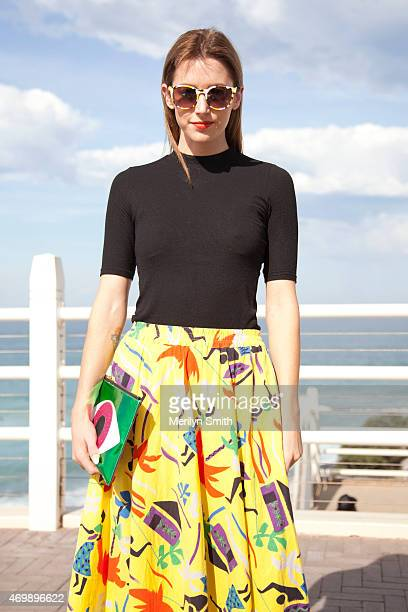Accessories Designer Poppy Lissiman wears her own design bag and sunglasses Topshop shirt vintage skirt at MercedesBenz Fashion Week Australia 2015...