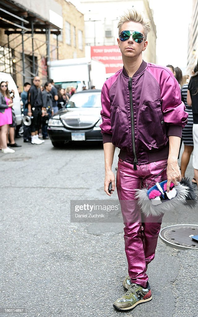Accessories director of Marie Claire Kyle Anderson is seen outside the DKNY show wearing an all Burberry outfit with a Fendi bag on September 8, 2013 in New York City.