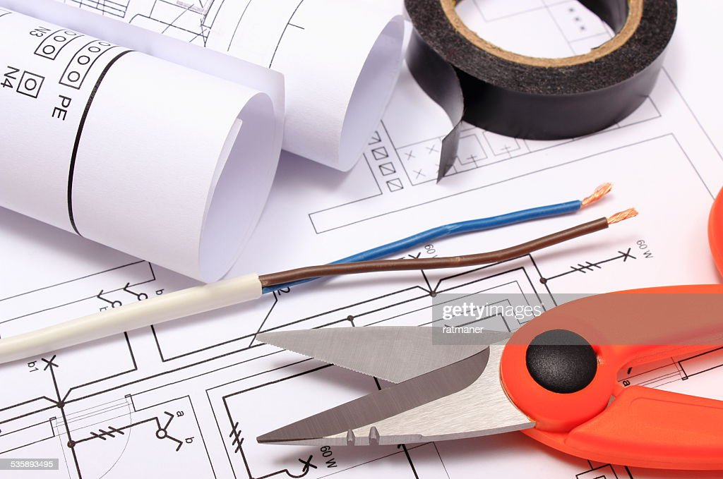 Accessories for engineer jobs and rolls of diagrams on drawing : Stockfoto