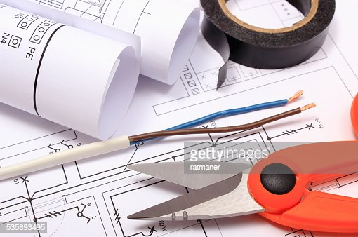 Accessories for engineer jobs and rolls of diagrams on drawing : Stock Photo