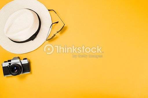 Accessories for travel top view yellow background with copy space : Stock Photo