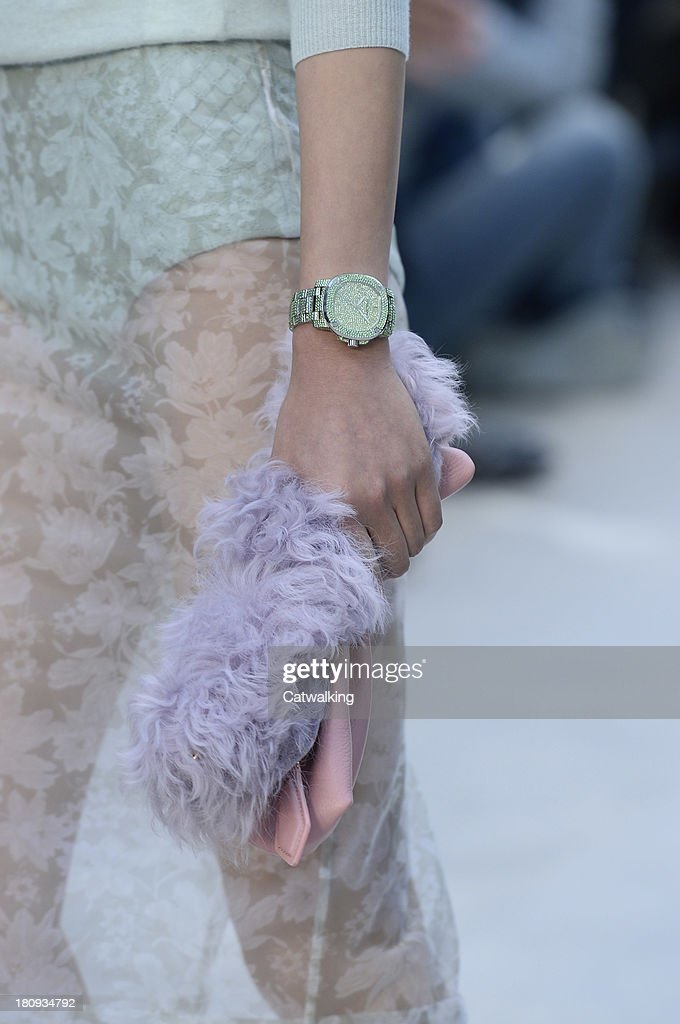 Accessories watch and bag detail on the runway at the Burberry Prorsum Spring Summer 2014 fashion show during London Fashion Week on September 16, 2013 in London, United Kingdom.