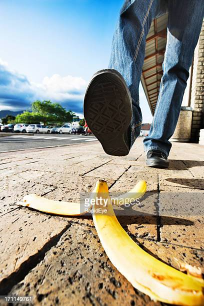 Accident about to happen: foot approaches banana peel  on street!