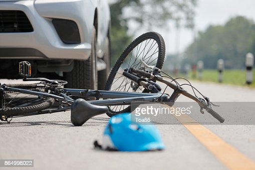 Accident car crash with bicycle on road : Stock Photo