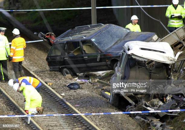 Accident investigators examine the area around the Landrover with trailer carrying another car that caused the Selby rail disaster when 13 people...