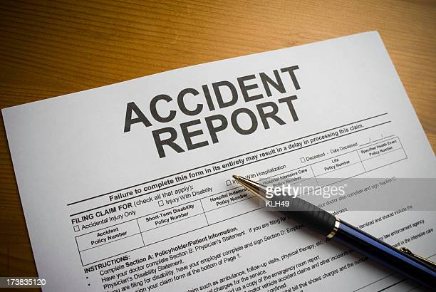 Accident report form on a desk with a pen