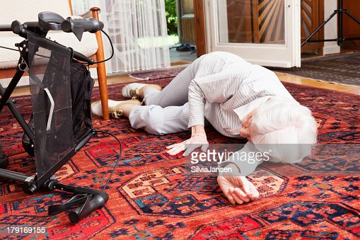 accident senior woman after fall lying on ground
