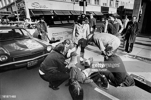 FEB 2 1978 Accident Victim Aided Anthony Ulibarri of 607 E 22nd Ave is given firstaid treatment in the street after being struck by a car at 15th and...