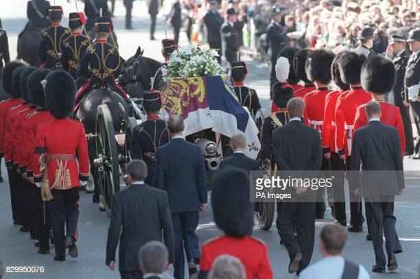 Accompanied by a bearer party of Welsh Guards the Royal Standarddraped coffin of Diana Princess of Wales is carried on a gun carriage of the King's...