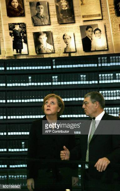 Accompanied by Avner Shalev Director of Yad Vashem German Chancellor Angela Merkel visits the Hall of Names within the Yad Vashem Holocaust museum in...