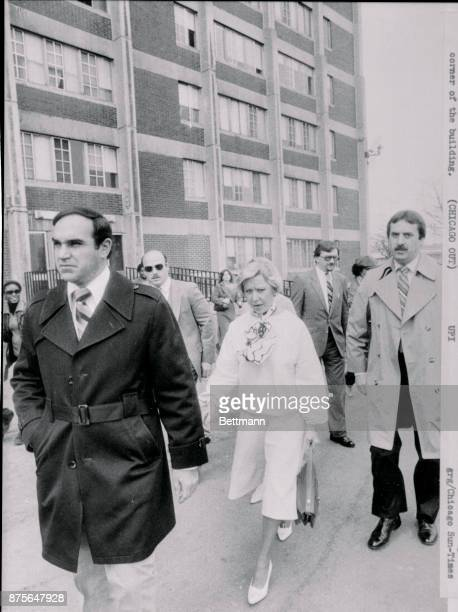 Accompanied by bodyguards Mayor Jane Byrne leaves a CabriniGreen apartment house after making a brief inspection of the apartment she will soon...