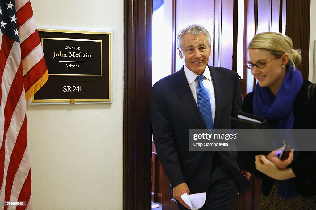 Accompanied by CIA Spokesperson Marie Harf (R), former U.S. Senator <a gi-track='captionPersonalityLinkClicked' href=/galleries/search?phrase=Chuck+Hagel&family=editorial&specificpeople=504963 ng-click='$event.stopPropagation()'>Chuck Hagel</a> leaves the Capitol Hill offices of Sen. John McCain (R-AZ) after the two Vietnam War veterans met January 22, 2013 in Washington, DC. Hagel, who cochaired McCain's 2000 presidential campaign, has been nominated by U.S. President Barack Obama to succeed Leon Panetta as Secretary of Defense.