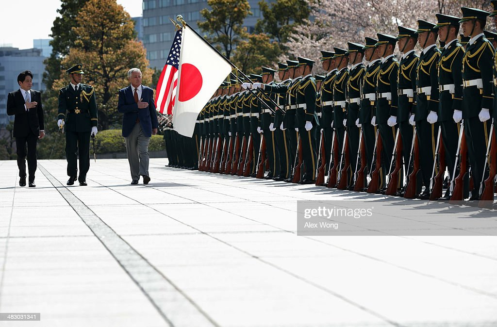 Accompanied by Japanese Defense Minister Itsunori Onodera (L), U.S. Secretary of Defense Chuck Hagel (R) reviews honor guards at the Japanese Ministry of Defense headquarters April 6, 2014 in Tokyo, Japan. Secretary Hagel is visiting Japan, China and Mongolia, his fourth trip to Asian nations since taking office.