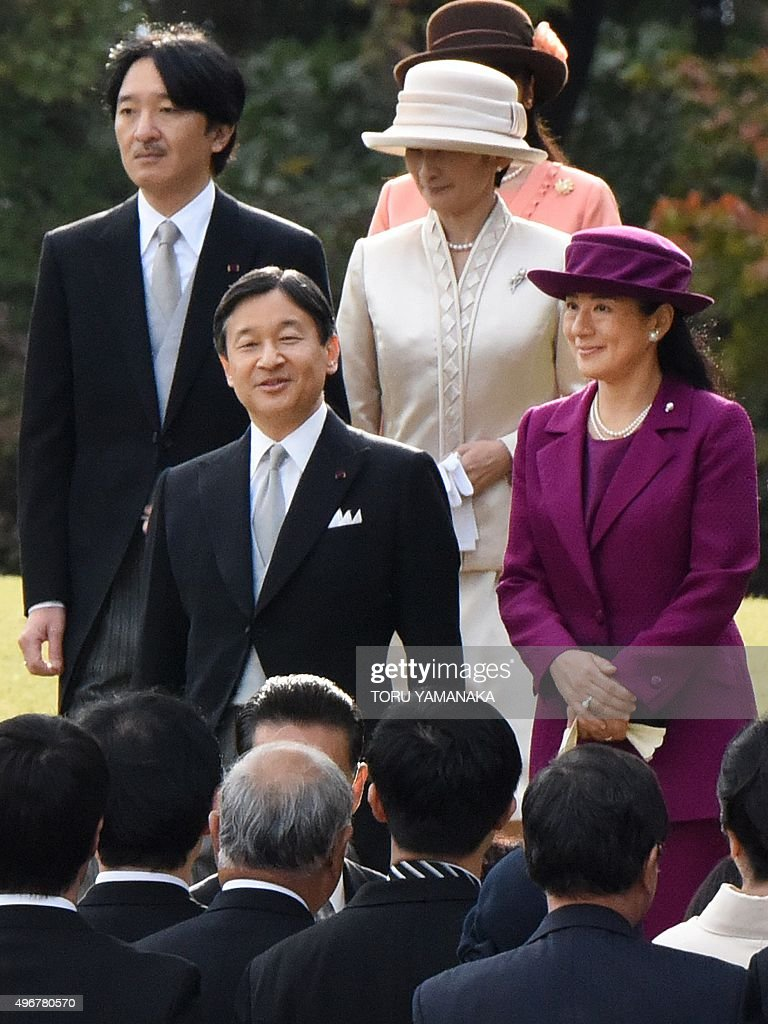 Accompanied by Prince Akishino (top L) and Princess Kiko (top R), Japanese Crown Prince Naruhito (L) and Crown Princess Masako (R) walk toward guests during the annual autumn garden party hosted by the emperor and empress at the Akasaka Palace imperial garden in Tokyo on November 12, 2015. Crown Princess Masako took part in the garden party at the first time since the autumn party in 2003. AFP PHOTO / POOL / Toru YAMANAKA