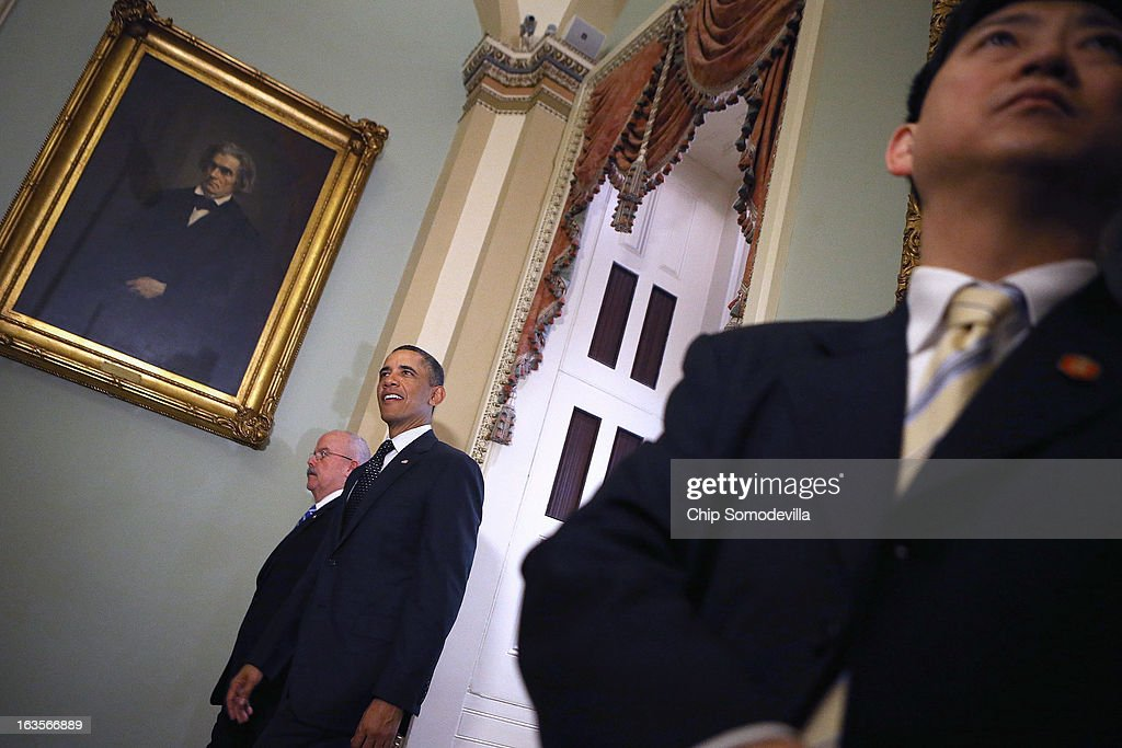 Accompanied by Sergeant at Arms of the United States Senate Terrance Gainer (L), U.S. President <a gi-track='captionPersonalityLinkClicked' href=/galleries/search?phrase=Barack+Obama&family=editorial&specificpeople=203260 ng-click='$event.stopPropagation()'>Barack Obama</a> leaves after meeting with members of the Senate Democatic Caucus in the Mansfield Room at the U.S. Capitol March 12, 2013 in Washington, DC. With tax reform, spending cuts, gun control and immigration on the agenda, Obama will be holding four meetings over three days this week with Republican and Democratic members of Congress at the U.S. Capitol.